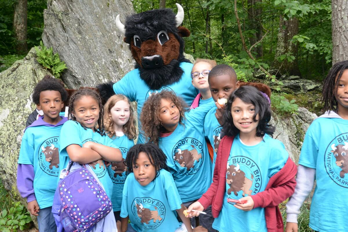 Let's get Every Kid in a Park! A group of kids with Buddy Bison of the National Park Trust.