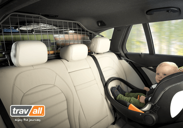 Infant in rear-facing car seat with a Travall Guard installed in the vehicle