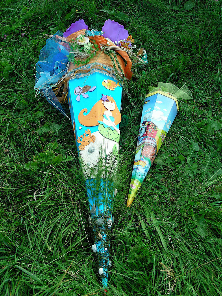 A couple of Schultüte (large paper cones stuffed with candy toys and gifts), The larger is decorated with sea creatures and a mermaid for the child entering school. And a second smaller one for their sibling.