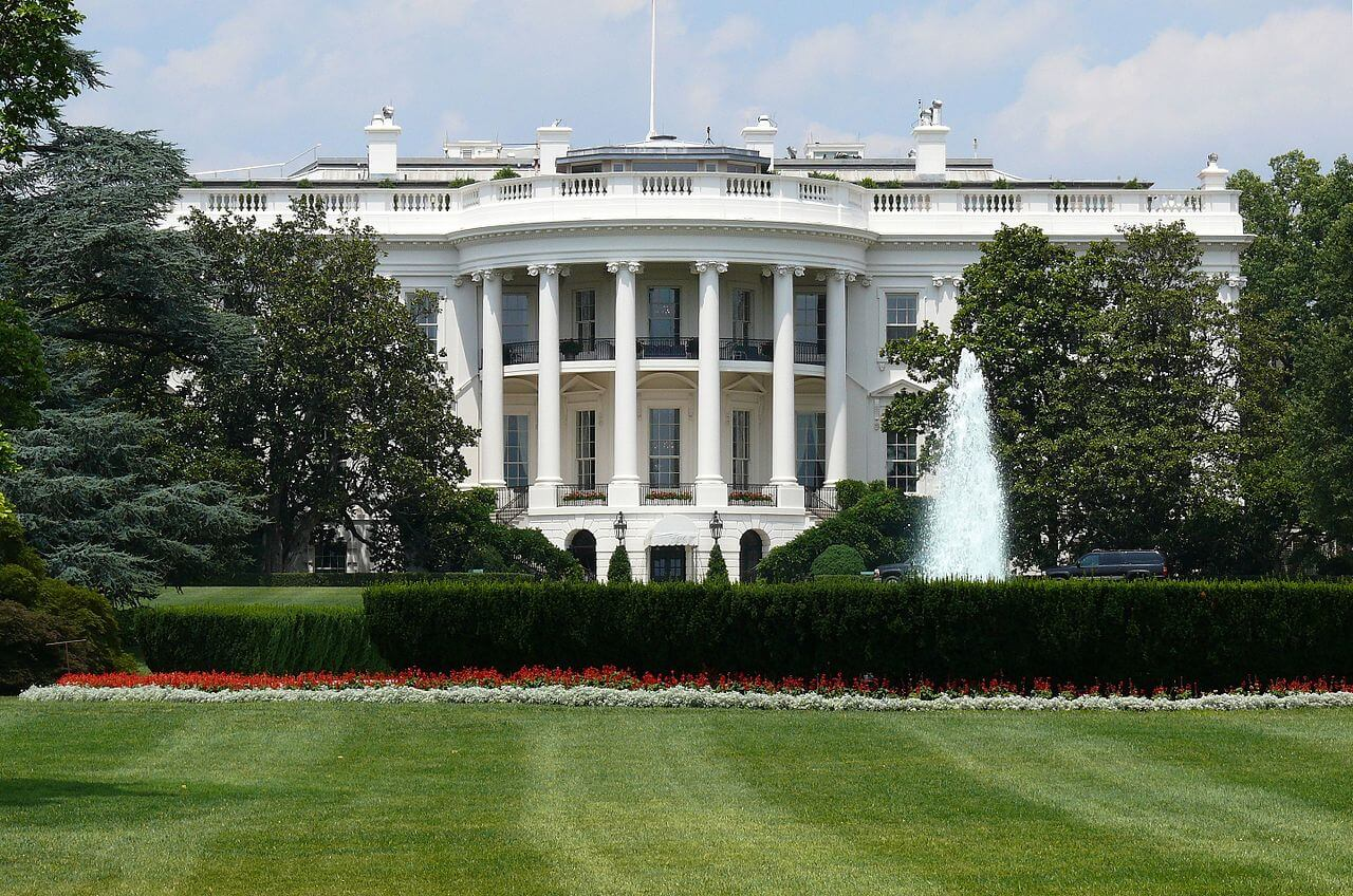 A shot of the White House from the south with a fountain on the right. Photo courtesy of Ad Meskins on Wikimedia.