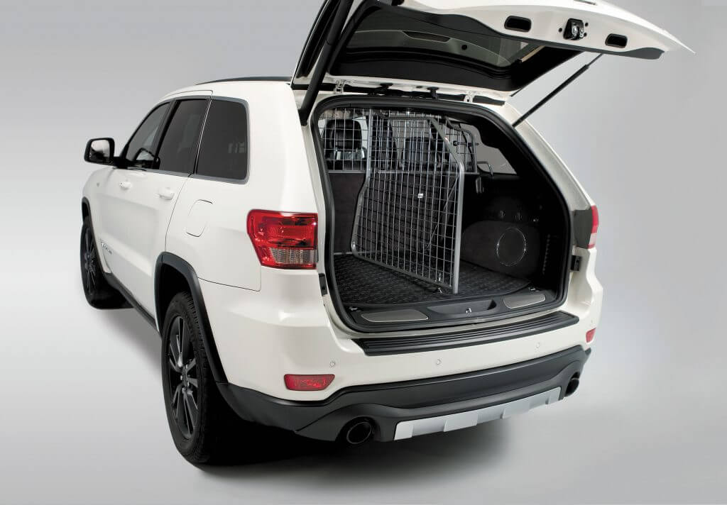Rear view of a Travall Guard and Divider in a white Jeep Grand Cherokee.