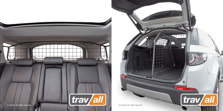 Interior view of the Travall Guard and rear view of the Travall Divider installed in the Land Rover Discovery Sport.